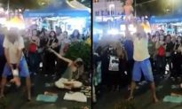 Russian 'Begpacker' Couple Arrested in Malaysia After Baby-Swinging Video Sparks Outrage
