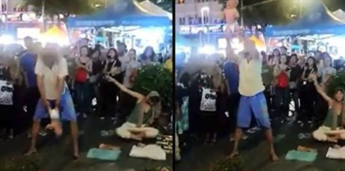 Authorities in Malaysia have announced the arrest of a Russian couple after footage went viral of a baby being flung around during a street act in Kuala Lumpur, Malaysia, on Feb. 4, 2019. (Royal Malaysia Police)