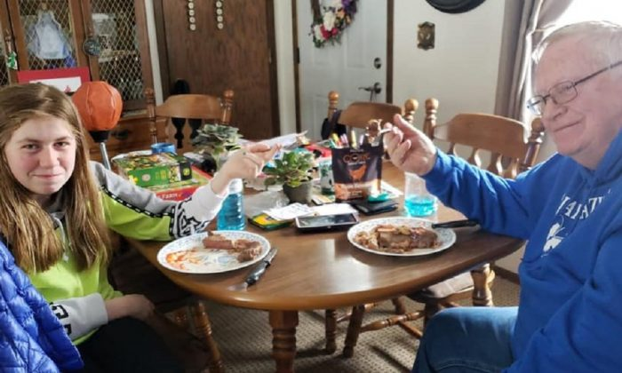 Jayme Closs, 13, and her grandfather Robert Naiberg enjoying a meal on Feb. 3, 2019. (Light the way home for Jayme/Facebook)