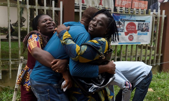 A returnee migrant (C) brought home from Libya is embraced by relatives in Benin, capital of Edo State in midwest Nigeria, on Dec. 7, 2017.  (Pius Utomi Ekpei/AFP/Getty Images)