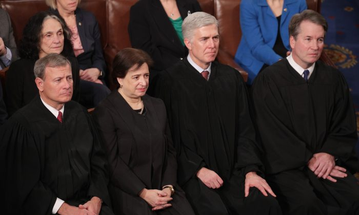 Supreme Court Justices John Roberts, Elena Kagan, Neil Gorsuch, and Brett Kavanaugh look on as President Donald Trump delivers the State of the Union address in the chamber of the U.S. House of Representatives on Feb. 5, 2019. (Alex Wong/Getty Images)