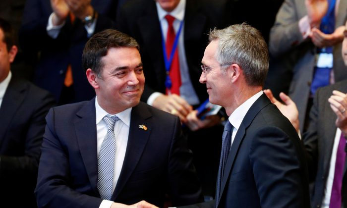 Macedonian Foreign Minister Nikola Dimitrov shakes hands with NATO Secretary General Jens Stoltenberg in Brussels on Feb. 6, 2019. (Francois Lenoir/Reuters)