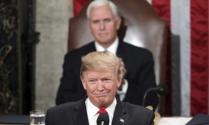 President Donald Trump delivers his State of the Union address to a joint session of Congress on Capitol Hill in Washington, as Vice President Mike Pence watches on Feb. 5, 2019. (AP Photo/Andrew Harnik)