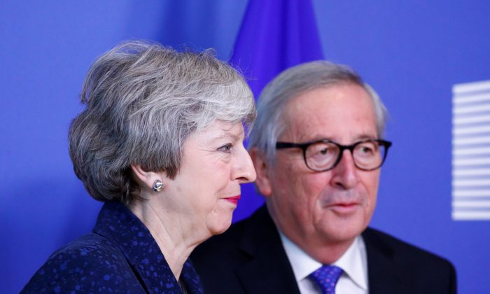European Commission President Jean-Claude Juncker meets with British Prime Minister Theresa May in Brussels on Feb. 7, 2019. (Francois Lenoir/Reuters)