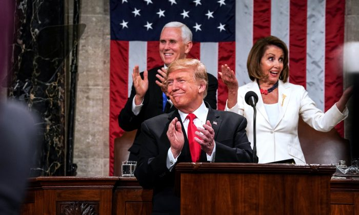 President Donald Trump, Speaker Nancy Pelosi and Vice President Mike Pence applaud during the State of the Union address in the chamber of the U.S. House of Representatives on Feb. 5, 2019. (Doug Mills-Pool/Getty Images)