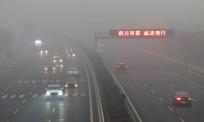 Air pollution made travel difficult in China during the Chinese new year of 2019. This photo was taken in Beijing on March 17, 2012. (STR/AFP/Getty Images)