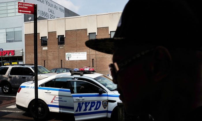 """File photo of a New York Police Department police car patrolling an area that had witnessed an explosion in the use of K2 or """"Spice,"""" a synthetic marijuana drug, in East Harlem, New York City, on Sept. 2, 2015. (Spencer Platt/Getty Images)"""