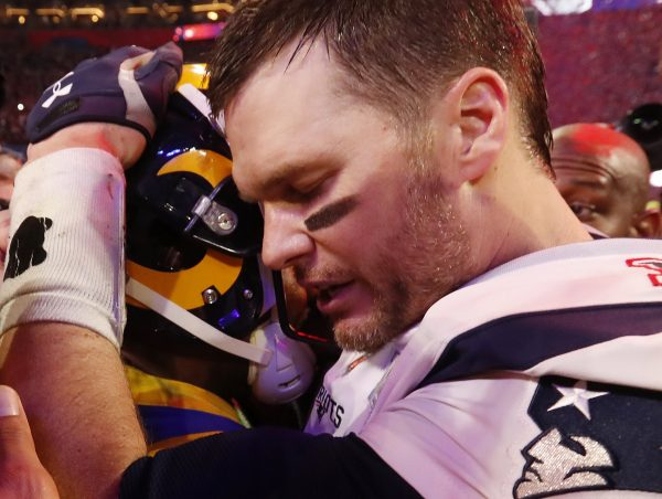 Tom Brady consoles player