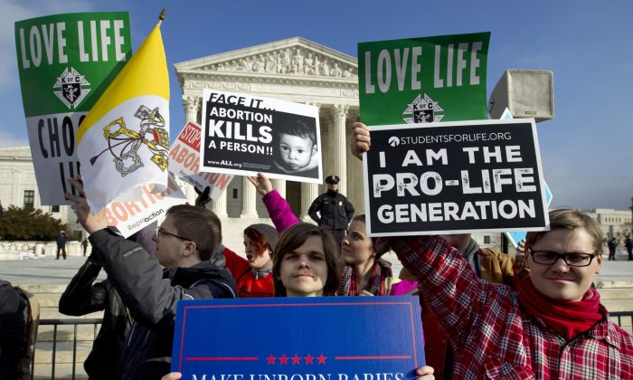 Anti-abortion activists protest outside of the U.S. Supreme Court, during the March for Life in Washington. on Jan. 18, 2019. (Jose Luis Magana/AP Photo)