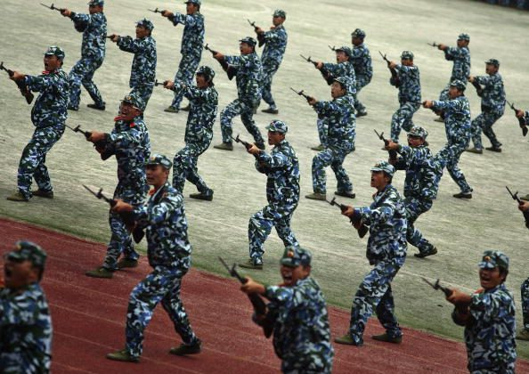 Freshmen practice fighting skills during a military training at a university in Gaochun County in coastal China's Jiangsu Province, on Sept. 25, 2008. (China Photos/Getty Images)