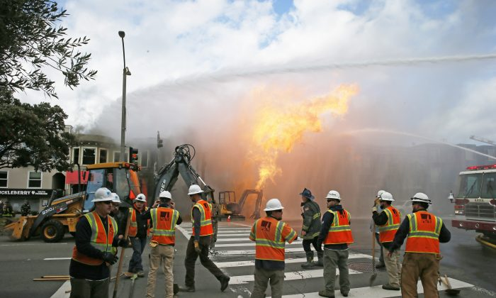 PG&E officials as firefighters battle a fire following an explosion in San Francisco, Calif., on Feb. 6, 2019. (Santiago Mejia/San Francisco Chronicle via AP)