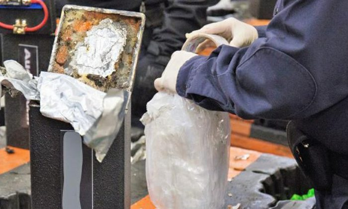 An officer extracting methamphetamine from a loudspeaker at the Los Angeles-Long Beach seaport on Jan. 11, 2019. (U.S. Customs and Border Protection via AP)