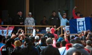 Migrant Caravan Detained in Old Factory, Across From Texas