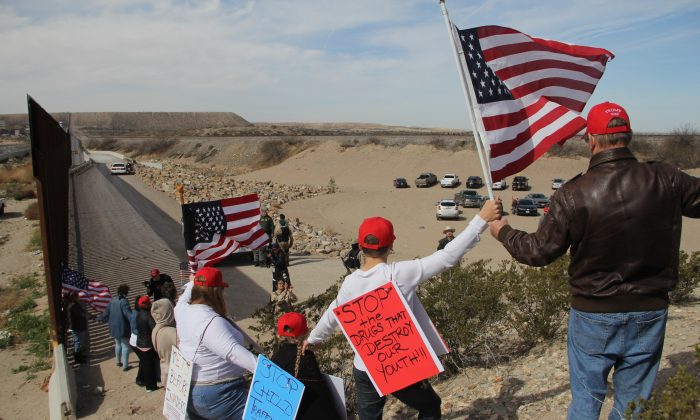Supporters of increased security along the U.S.-Mexico border make a human wall to demonstrate their support for a border wall, at Sunland Park, N.M., on Feb. 9, 2019. (Hericka Martinez/AFP/Getty Images)
