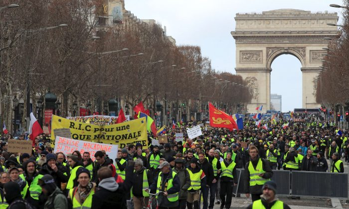 Protesters in a demonstration by the 'yellow vests' movement in Paris on Feb. 9, 2019. (Gonzalo Fuentes/Reuters)