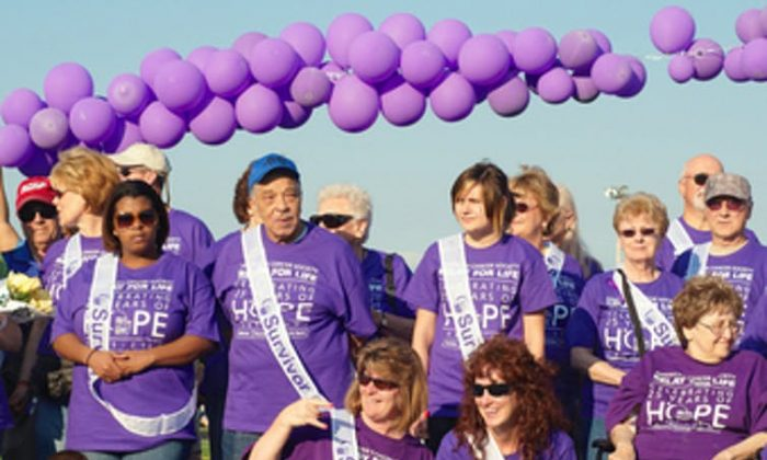 Cancer survivors are honored at a Relay for Life Event in Twinsburg, Ohio, in June 2009. Researchers found that many survivors do not like that label. (KennethSponsler/Shutterstock)