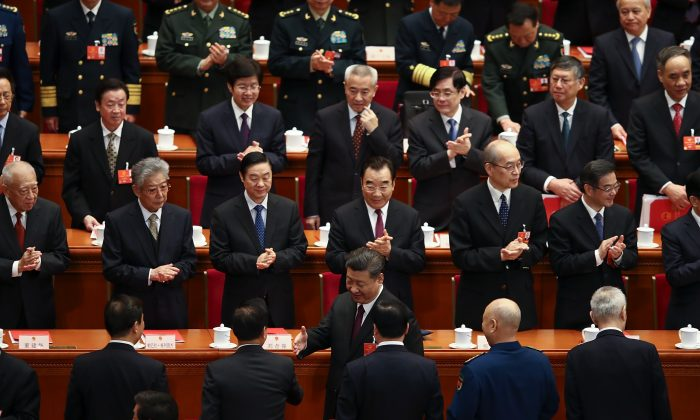 Chinese communist officials attended the closing session of the National People's Congress (NPC) at the Great Hall of the People on March 20, 2018 in Beijing, China.  (Lintao Zhang/Getty Images)