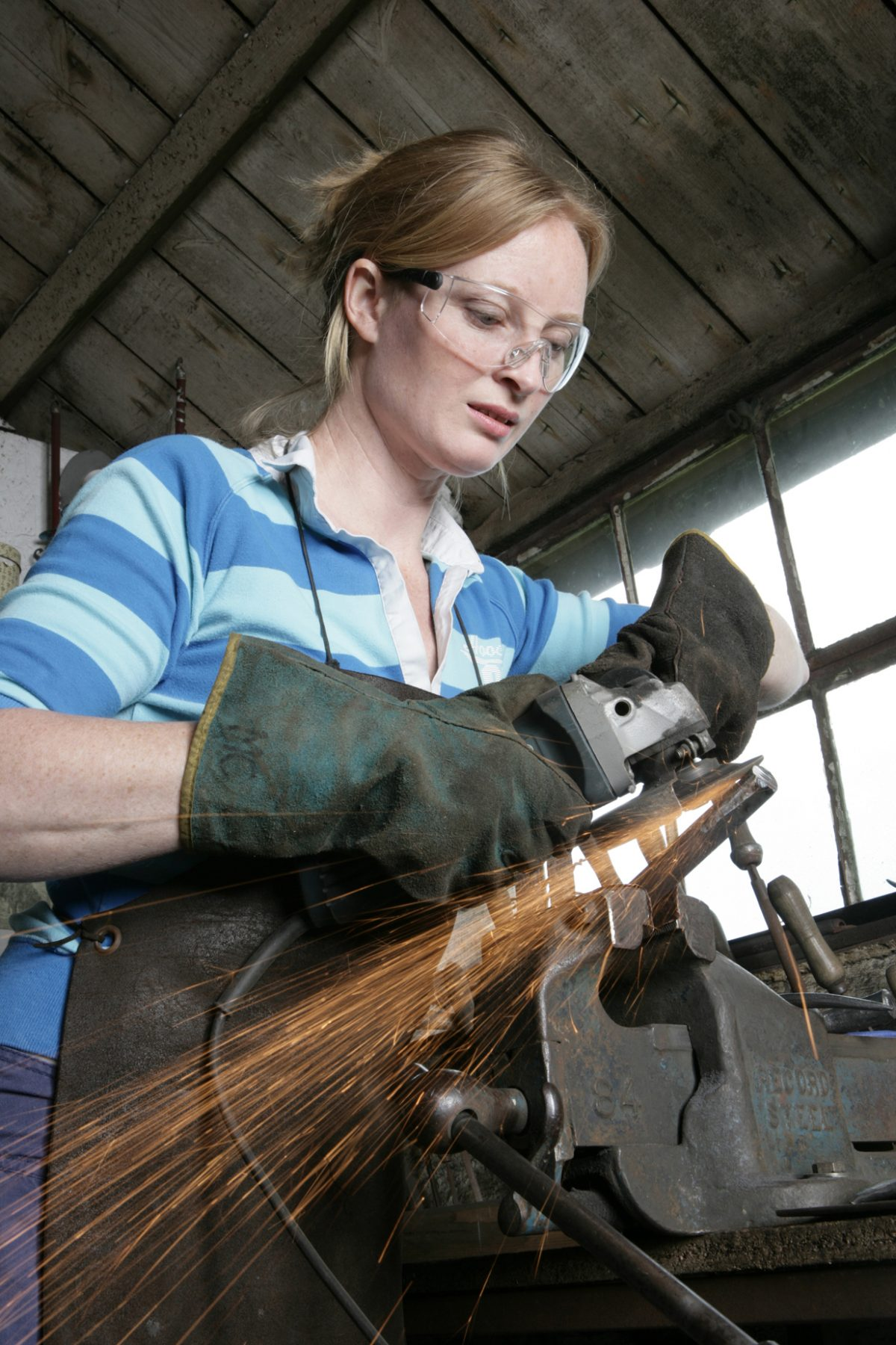 Blacksmith working woman