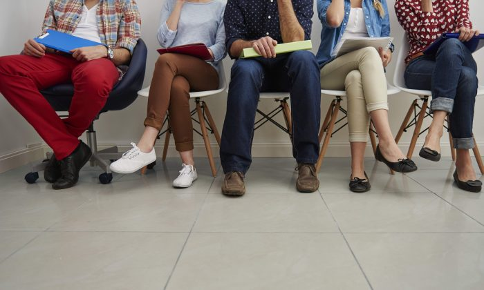 Your sitting position reveals your personality. (Gpointstudio/Shutterstock)