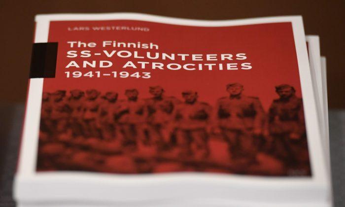 The research document entitled The Finnish SS-volunteers and atrocities 1941 - 1943 against Jews, detailing atrocities against civilians and Prisoners of War in Ukraine and the Caucasus Region, pictured in Helsinki, Finland, on Feb. 8, 2019. (Heikki Saukkomaa/Lehtikuva via AP)
