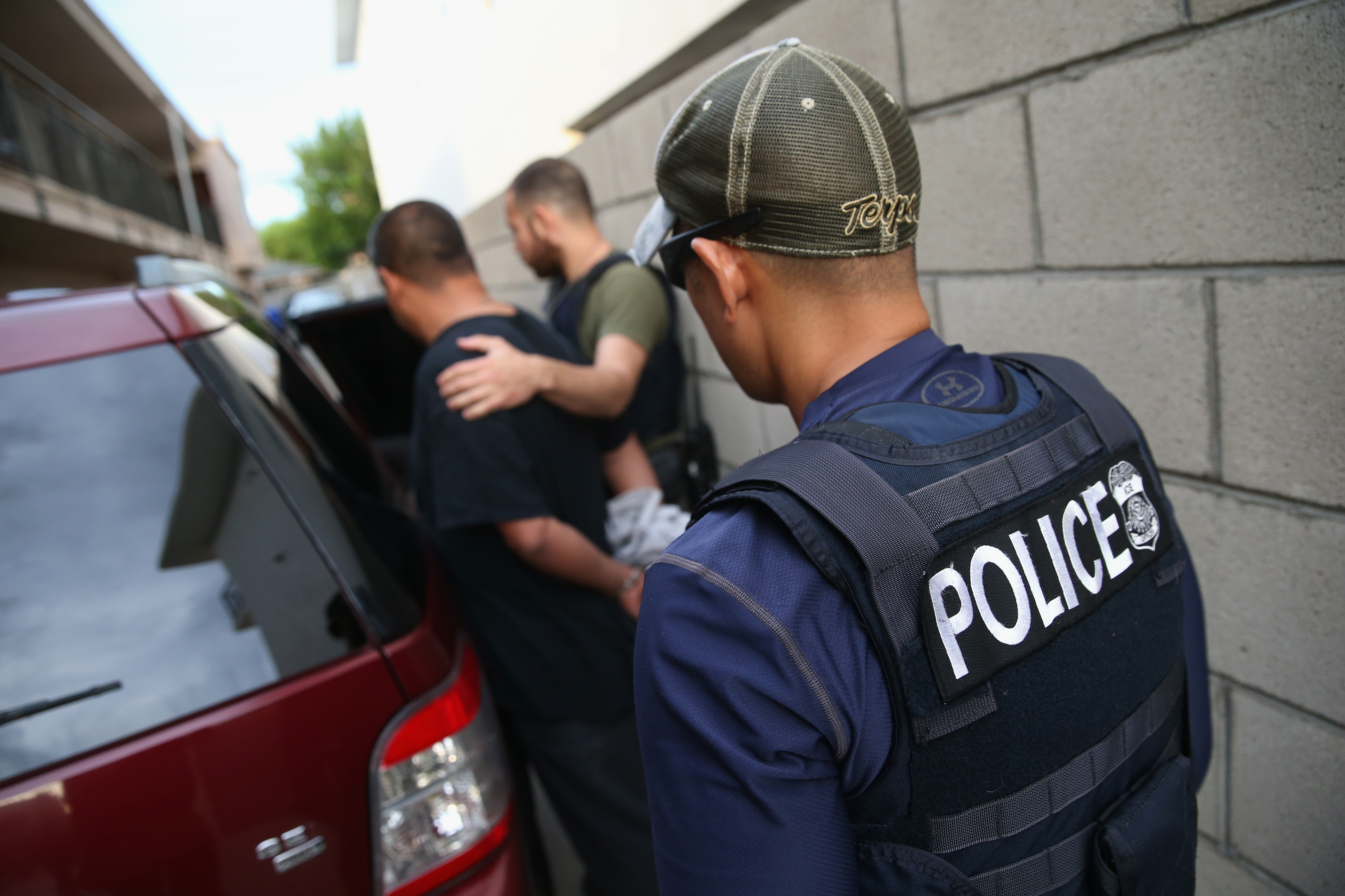 A man is detained by U.S. Immigration and Customs Enforcement (ICE), agents