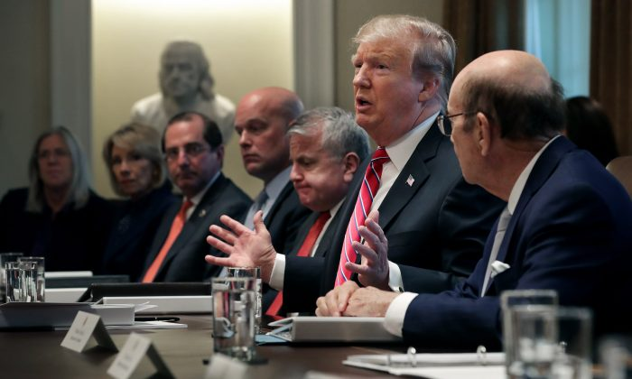 President Donald Trump talks to reporters during a meeting of his cabinet in the Cabinet Room at the White House in Washington on Feb. 12, 2019. (Chip Somodevilla/Getty Images)