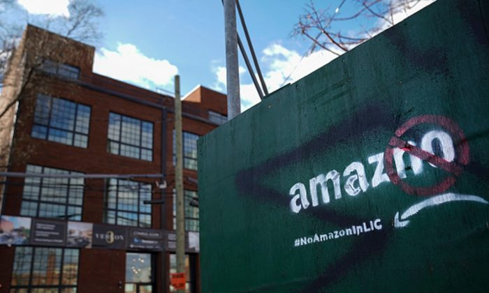 A protest message directed at Amazon is spray painted on a wall near a construction site in the Long Island City neighborhood of the Queens borough of New York City, on Jan. 9, 2019. (Drew Angerer/Getty Images)