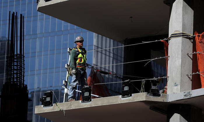 A construction worker stands on a floor of a building under construction on October 5, 2018 in San Francisco, California. (Justin Sullivan/Getty Images)