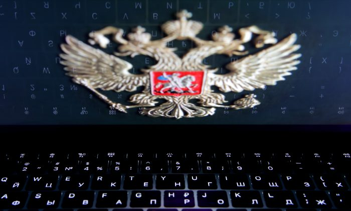 The coat of arms of Russia reflected in a laptop screen in a picture illustration on Feb. 12, 2019. (Maxim Shemetov/Reuters)