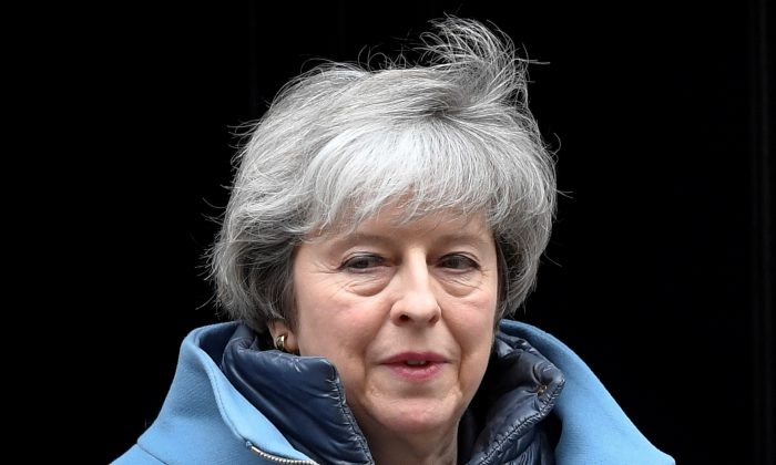 Britain's Prime Minister Theresa May is seen outside Downing Street in London on Feb. 12, 2019. (Toby Melville/Reuters)