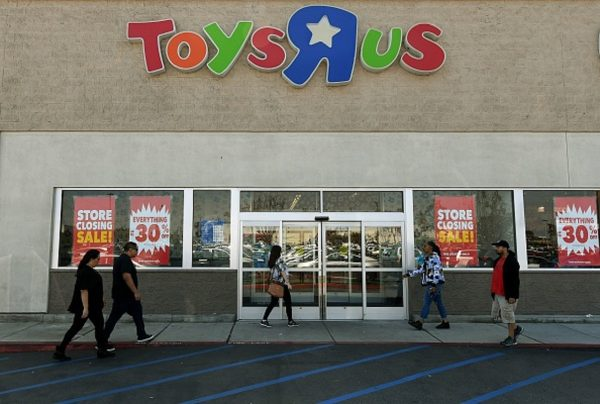 Customers shop at a Toys 'R' Us store,