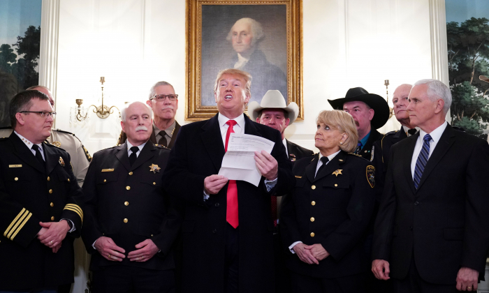 President Donald Trump (C) speaks during a meeting with sheriff's from around the country as US Vice President Mike Pence (R) looks on in the Diplomatic reception room at the White House in Washington, on Feb. 11, 2019. (Mandel Ngan/ AFP)