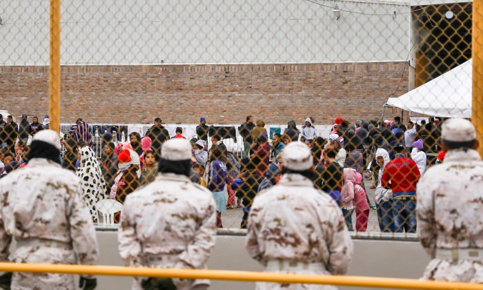 Mexican police and military personnel guard the outside of an old factory where around 1,800 Central American migrants are being held in Piedras Negras, Mexico, on Feb. 8, 2019. The majority of the migrants are hoping to get into the United States and claim asylum. (Charlotte Cuthbertson/The Epoch Times)