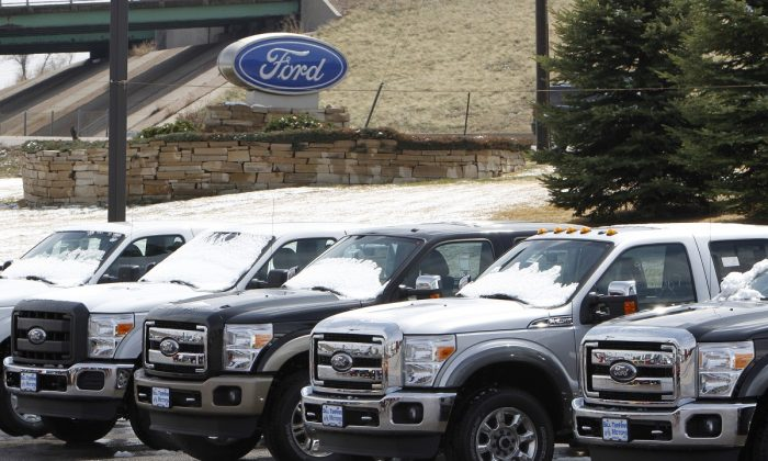 A row of new Ford F-150 pickup trucks are parked for sale at a Ford dealer in the Denver suburb of Broomfield, Colorado, on April 14, 2011. (Rick Wilking/Reuters)