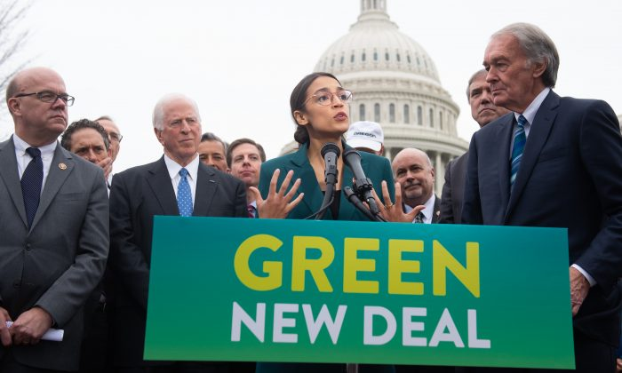 Rep. Alexandria Ocasio-Cortez, D- N.Y., and Sen. Ed Markey (R), D-Mass., speak during a press conference to announce Green New Deal legislation to promote clean energy programs outside the Capitol in Washington, Feb. 7, 2019. SAUL LOEB/AFP/Getty Images)