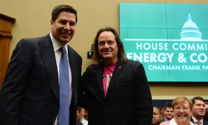 Sprint Executive Chairman Marcelo Claure and T-Mobile US CEO John Legere testify before a U.S. House Committee on Energy and Commerce Subcommittee hearing in Washington, on Feb. 13, 2019. (Erin Scott/Reuters)