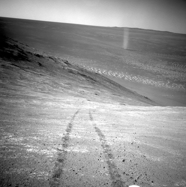 A dust devil in a valley on Mars