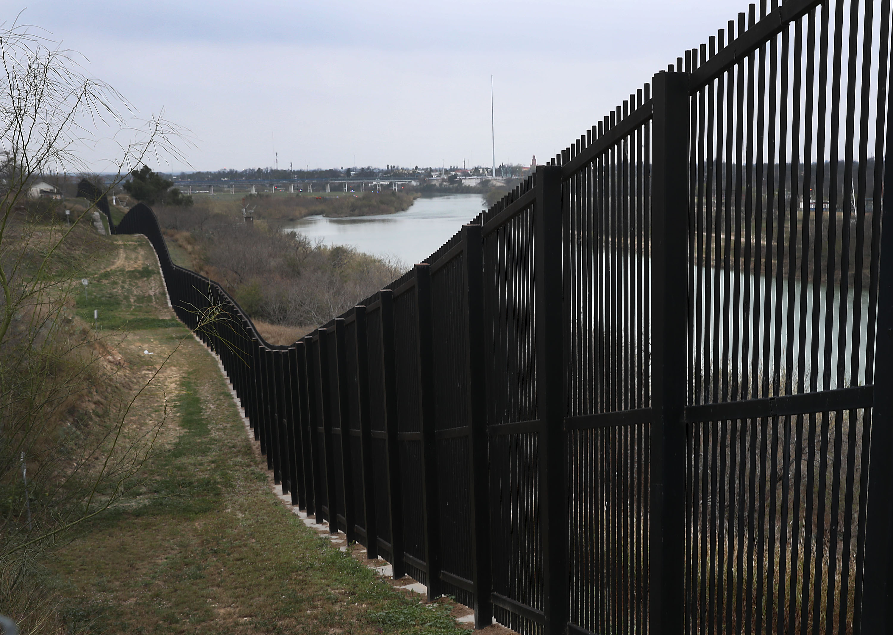 A border fence is seen near the Rio Grande which marks the boundary between Mexico and the United States in Eagle Pass