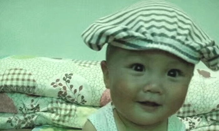 Undated photo of baby Han Xu, before the poisonous vaccination debilitated him in Hebei, China. (Han family)