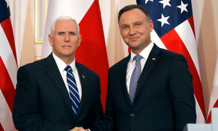 U.S. Vice President Mike Pence and Polish President Andrzej Duda shake hands during a joint news conference at Belvedere Palace in Warsaw, Poland on Feb. 13, 2019. (Kacper Pempel/Reuters)