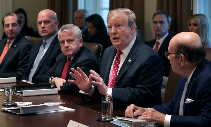 President Donald Trump talks to reporters during a meeting with members of his cabinet in the Cabinet Room at the White House on Feb. 12, 2019. (Chip Somodevilla/Getty Images)