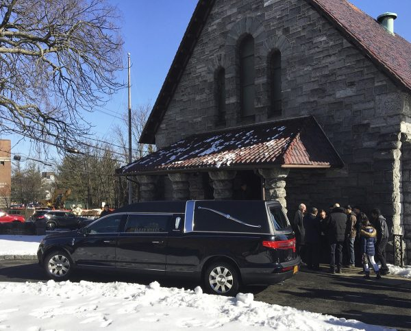 A hearse arrives at the funeral Mass for Valerie Reyes at St. Gabriel's Church