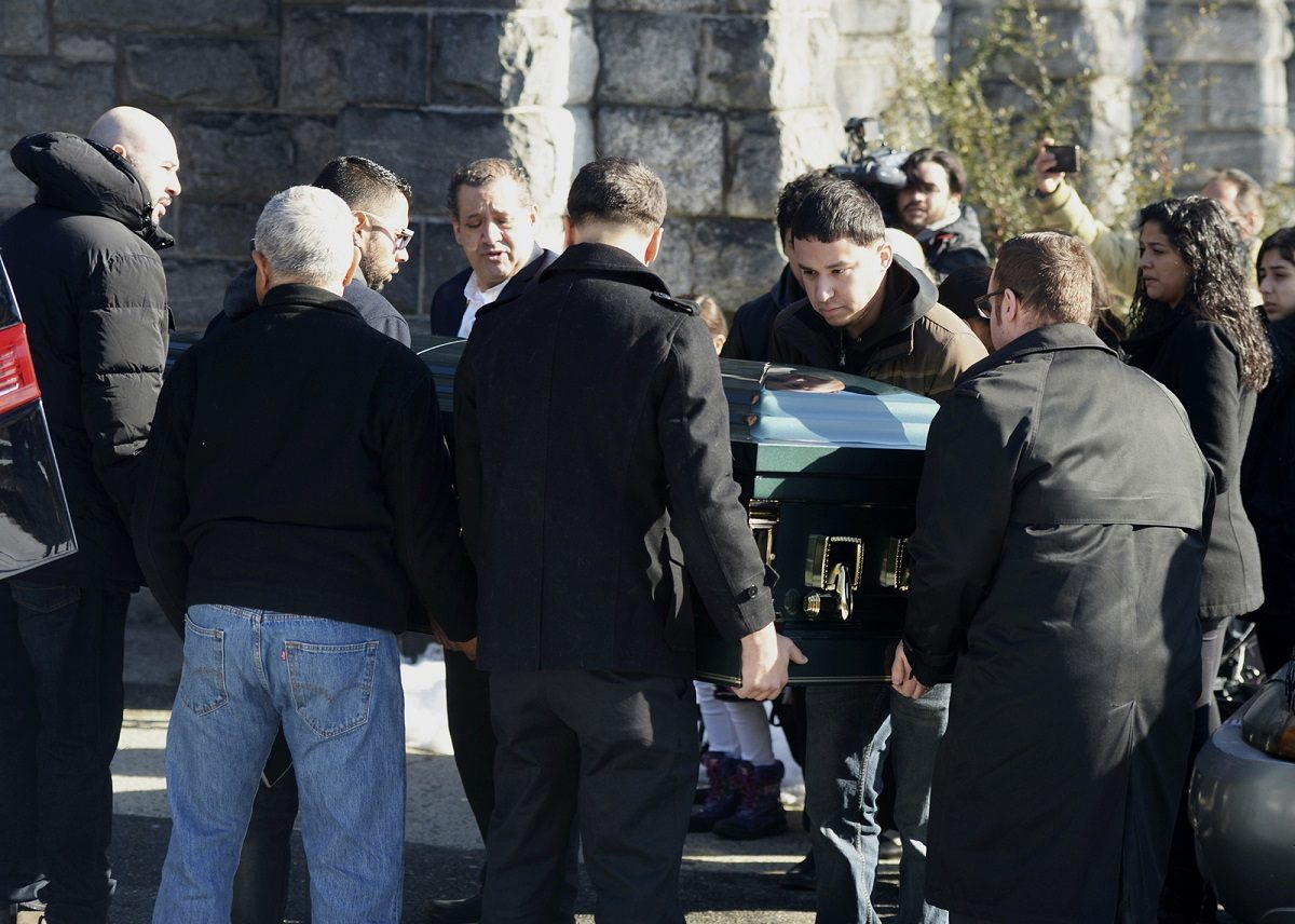 Pallbearers carry the casket of homicide victim Valerie Reyes into her funeral mass