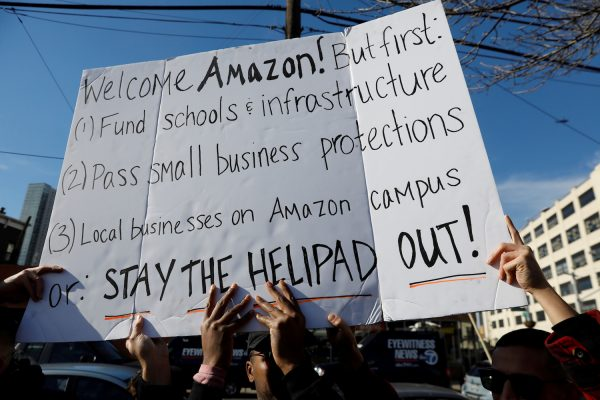 Demonstrators gather to protest Amazon's new location