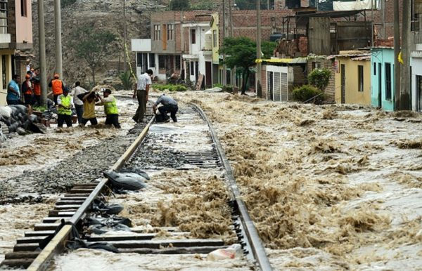 Men place sandbags along a section of the central railroad track
