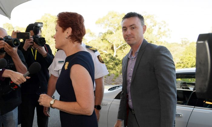 Senator Pauline Hanson and James Ashby (R) arrive at doors at Parliament House in Canberra, Australia, on Feb. 14, 2019. (Tracey Nearmy/Getty Images)