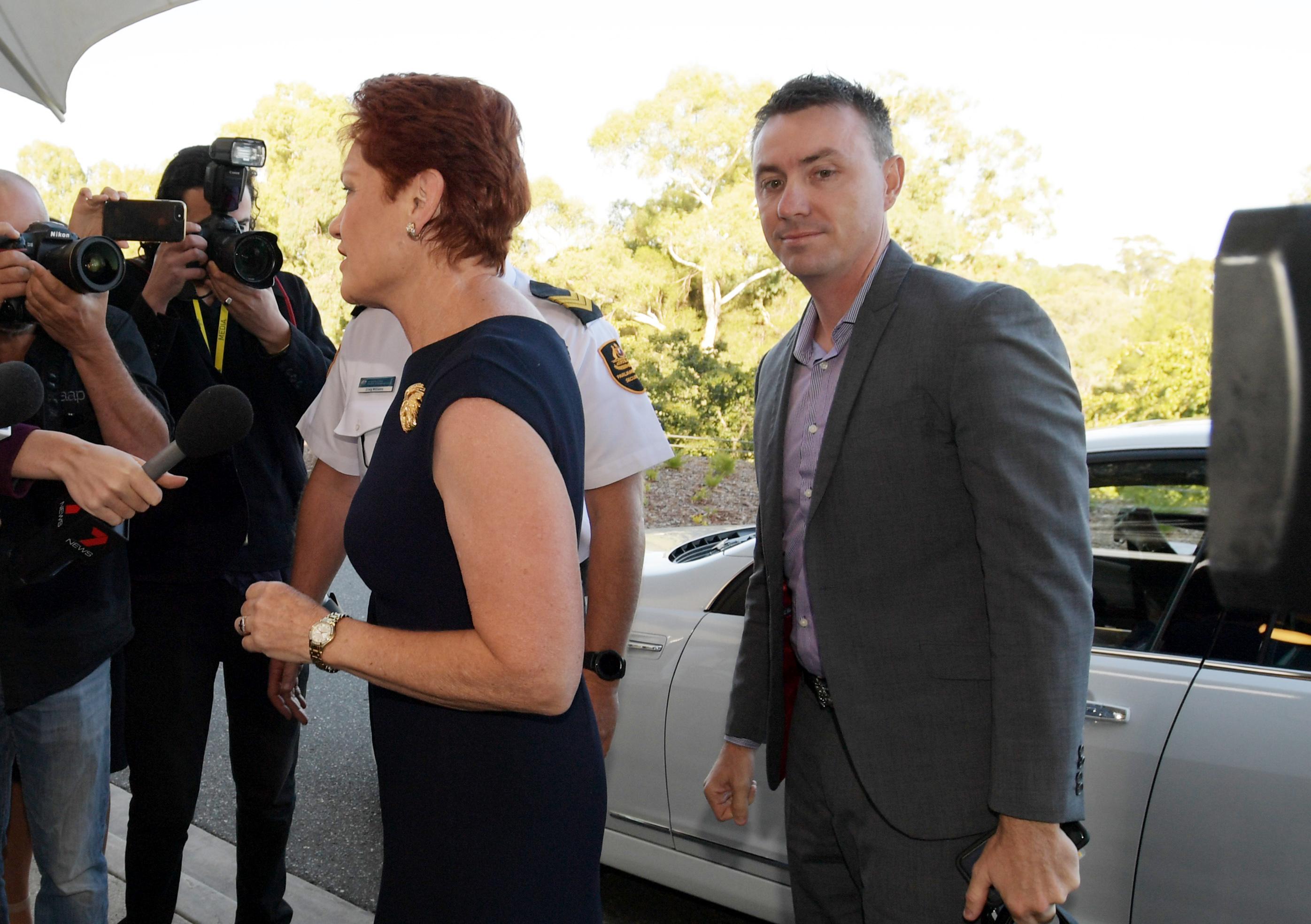 Senator Pauline Hanson and James Ashby (R) arrive at doors at Parliament House
