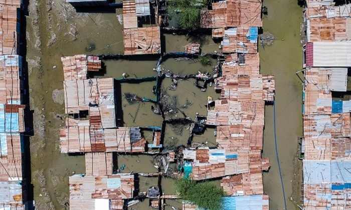 "An aerial view of flooded houses at the ""El Indio"" settlement on the outskirts of Piura, in northern Peru, on March 23, 2017.  (Leo Ramirez/AFP/Getty Images)"