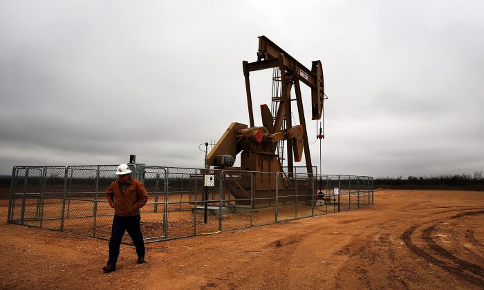 An oil well in the Permian Basin in Garden City, Tex., on Feb. 5, 2015. (Spencer Platt/Getty Images)