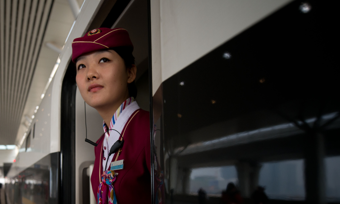A railroad attendant in China. (Ed Jones/AFP/Getty Images)
